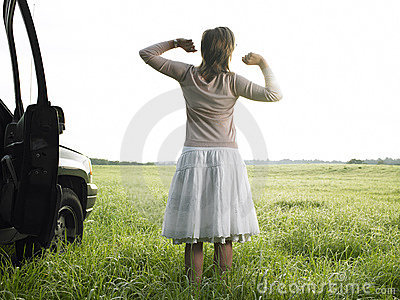 Woman in Field Stretching