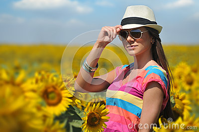 Woman in field with sunflowers