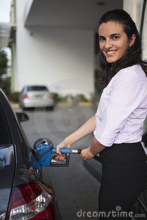 Woman fill up car