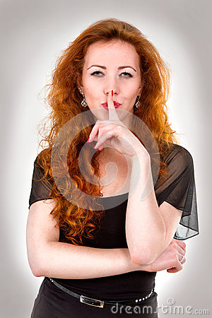 Woman with finger over mouth