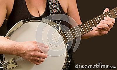 Woman finger-picking the banjo