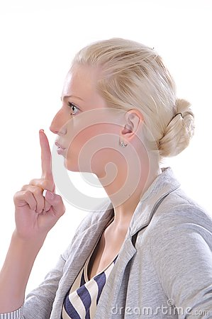 Woman with finger to mouth gesturing for quiet