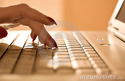 Woman fingers on laptop keyboard