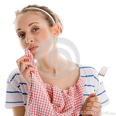 Woman finishing her lunch and wiping her mouth with napkin