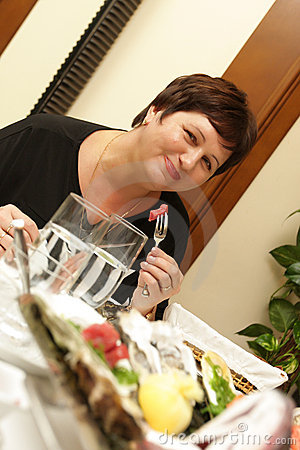 Woman in fish restaurant