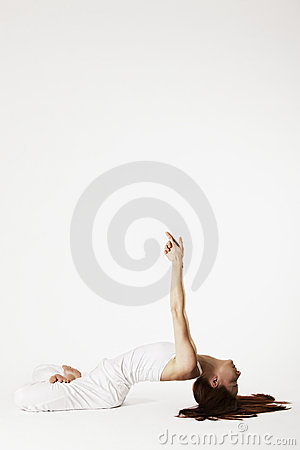 Woman in fish Yoga posture (Matsyasana)