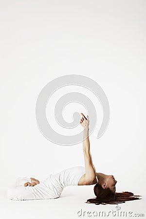 woman in fish yoga posture matsyasana stock photos
