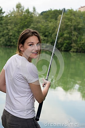 Woman Fishing at a lake