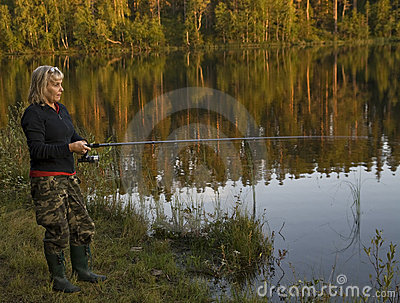 Woman fishing in lake