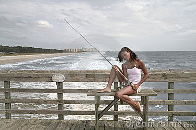 Woman fishing on the pier