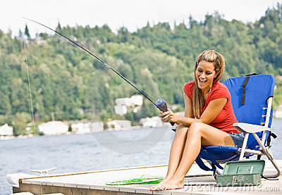 Woman fishing on pier