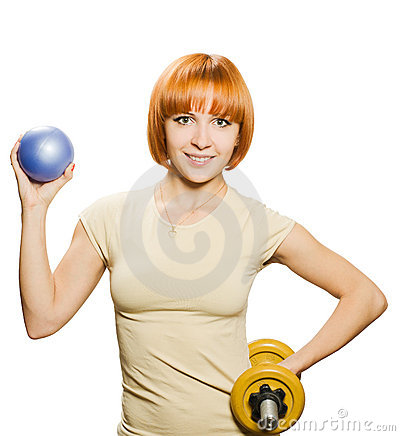 Woman with fitball and dumbbells
