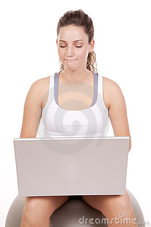 Woman fitness ball laptop happy