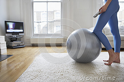 Woman By Fitness Ball Watching Television