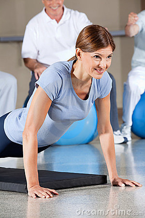 Woman in fitness center doing push