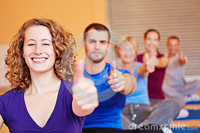 Woman in fitness center holding
