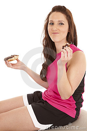 Woman fitness donut eat