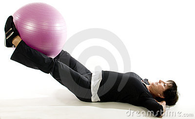 Woman fitness exercise leg raise  training ball