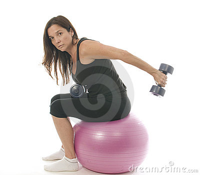 Woman fitness exercising  dumbbell weights cor