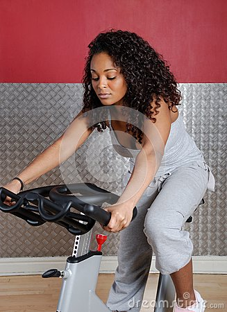 Woman fitness trainer on bicycle