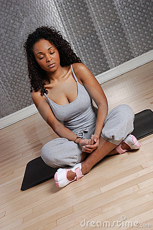 Woman fitness training and meditating