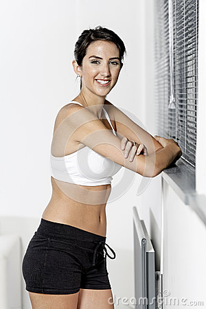 Woman in fitness wear at home