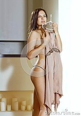 Woman fits on beige dress