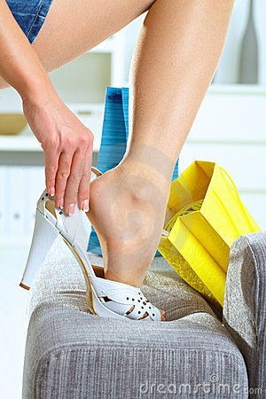 Free Woman Fitting High Heel Shoes Royalty Free Stock Photo - 9627655
