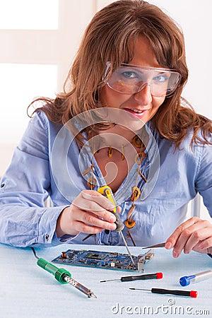 Woman fixing computer parts
