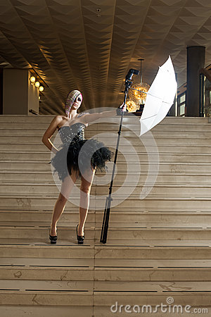 Woman with flash on stairs