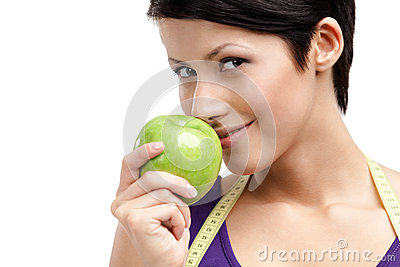 Woman with flexible ruler eating healthy fruit