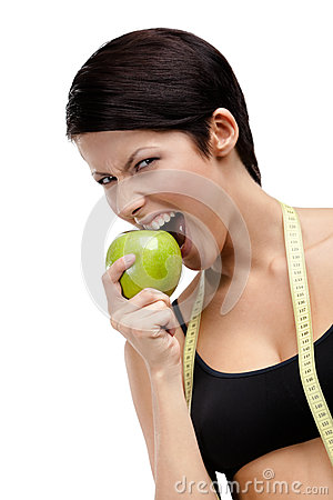Woman with flexible ruler and healthy apple