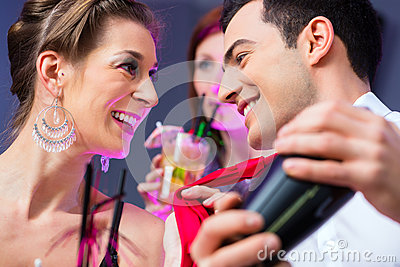 Woman flirting with barkeeper