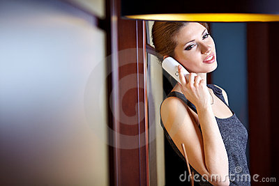 Woman flirting and chatting on the phone