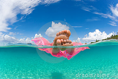 Woman float raft tropical water
