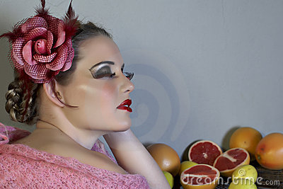 Woman with flower and fruit