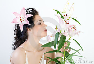 Woman with the flower by pink lily.