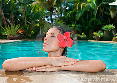 woman with flower in pool