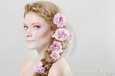 Woman with with flowers and roses in hair