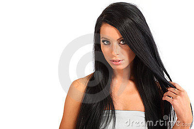 Woman with flowing hair looks mysteriously