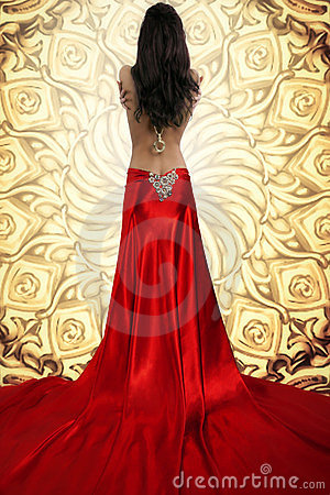 Woman In Flowing Satin Dress Royalty Free Stock
