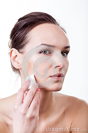 Woman with fluid swatches on face