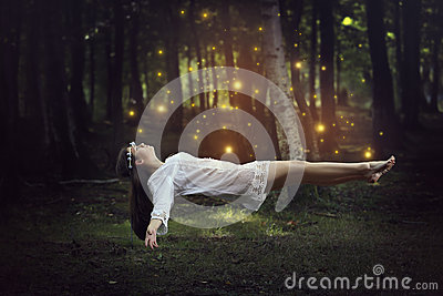 Woman Flying With Forest Fairies Stock Photo - Image: 46803672