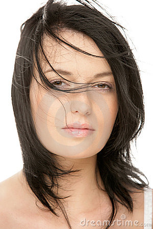 Woman with flying hair squinting eyes