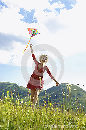 Free Woman Flying Kite Against Cloudy Sky Stock Photos - 31833373