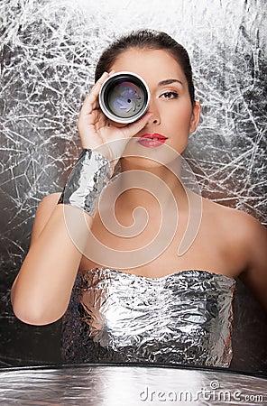 Woman in foil wear.