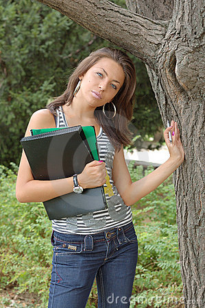 Woman with folders by tree