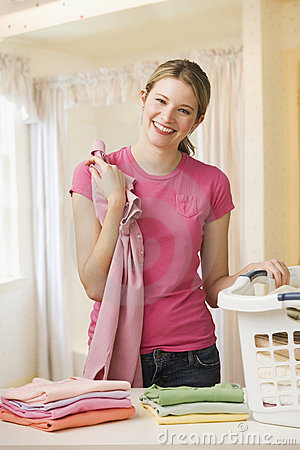 Woman Folding Laundry Royalty Free Stock Images - Image: 14647239
