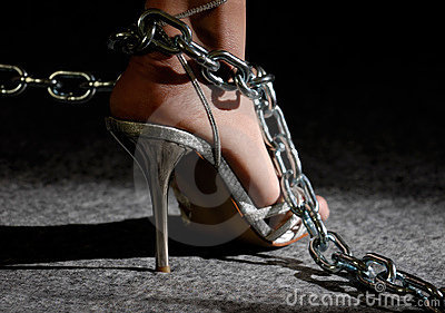 Woman foot in chains