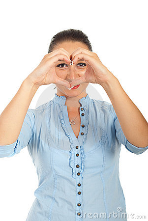 Woman forming heart in front of eyes